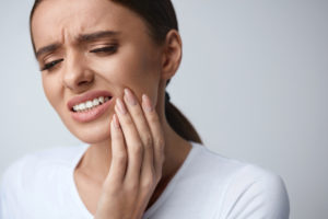 A woman in dental pain and eligible for a dental negligence claim